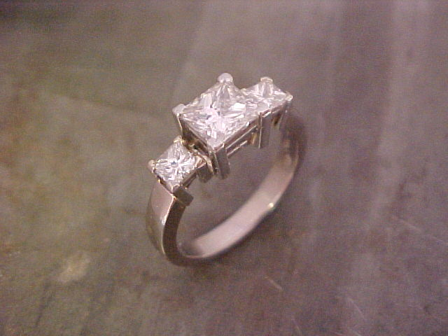 custom three stone engagement ring top view