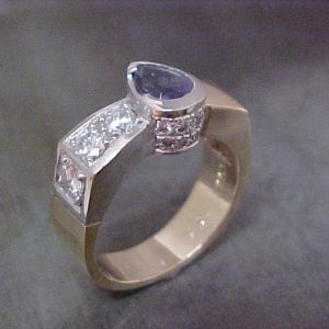 custom white gold ring with sapphire center stone and diamond band