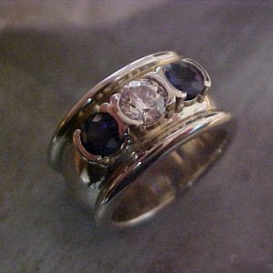 custom wide band ring with sapphires and center diamond