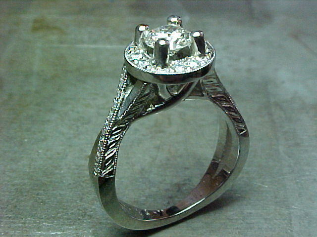 custom twist engagement ring with halo settinga nd custom engraving