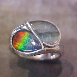 custom white gold ring with teardrop shaped center stones