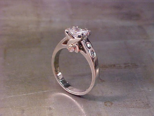 custom solitaire engagement ring with diamond accent band and custom engraving
