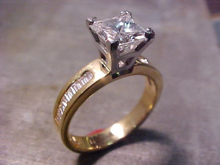 custom engagement ring with yellow gold band and white gold setting with large solitaire diamond