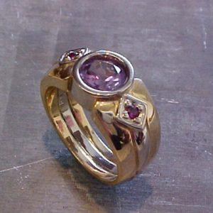 custom gold ring with purple gems
