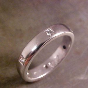 custom white gold wedding band with diamond accents