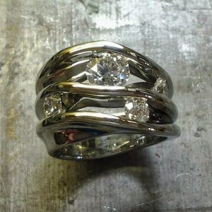 asymmetrical white gold with three diamonds top view