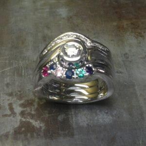 custom family ring with multiple birthsones and diamonds