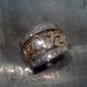 wide band custom swirl design with diamonds and leaves