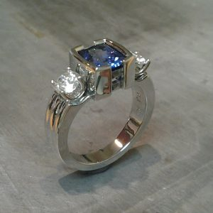 white gold with diamonds and large sapphire in square setting