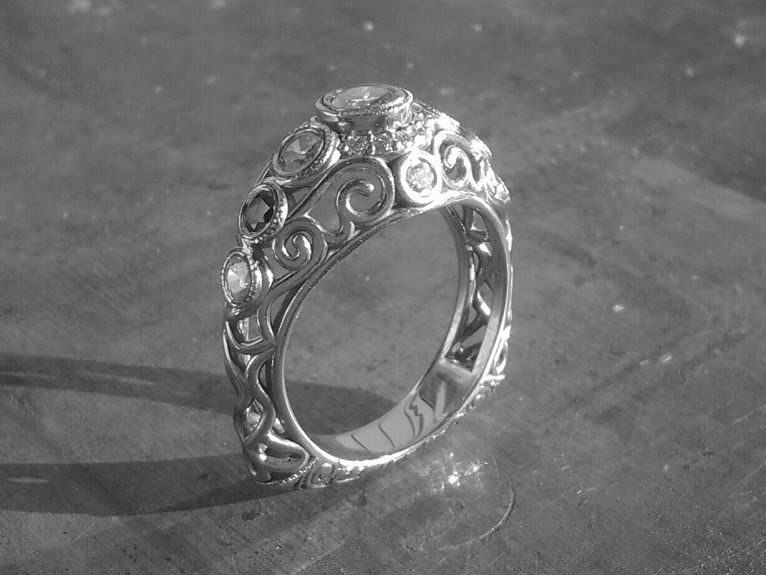 Open style Art deco inspired scroll engagement ring.