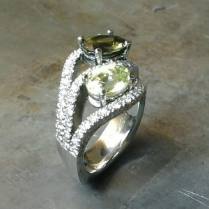 side view Colored gemstone multi-diamond encrusted ring.