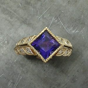 Purple stone engagement ring diamond leaves