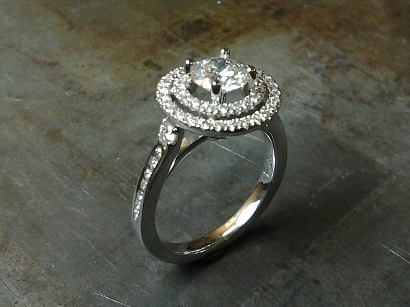 Double halo 19k white gold engagement ring