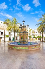 Beautiful and multi-colored fountain in a square, multi-tiered