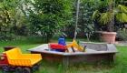 Ferienhaus Ferienwohnung Sandkasten im Garten