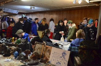 The lodge was crowded with customers searching for items to buy.