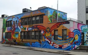 On Forsyth Street, the Latino Student Cultural Center is the canvas for Susan Cervantes' mural in collaboration with students of Northeastern.