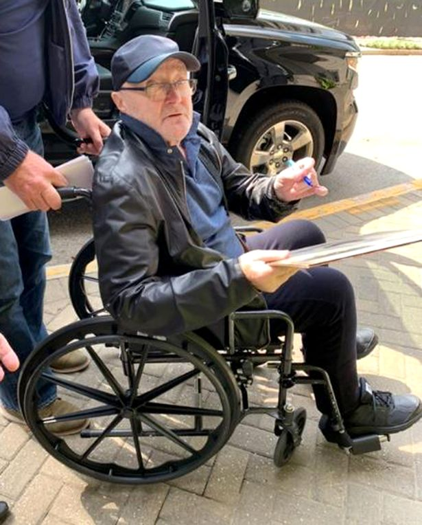 1_PAY-EXCLUSIVE-A-Very-Frail-Looking-Phil-Collins-Arrives-To-His-Hotel-In-Wheelchair-Ahead-Of-His-Schedul