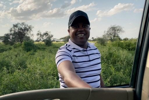 Smiling Kenyan driver for family safari in Kenya