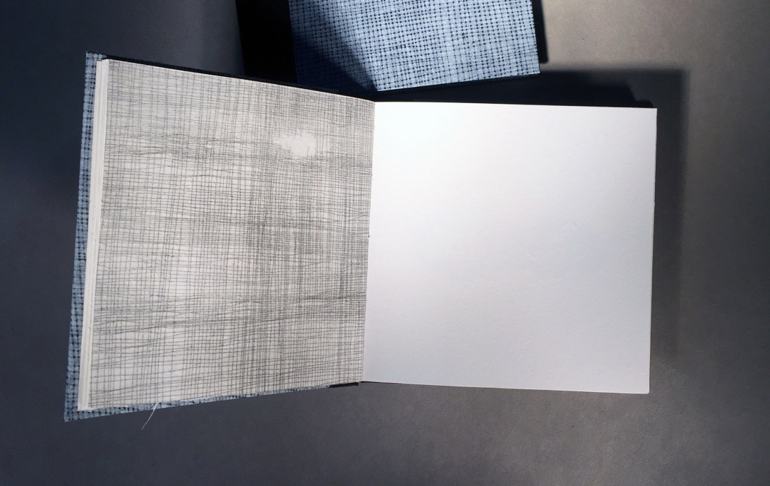 """interior page of an artist book titled """"1 over 1"""", artwork that looks like a screen or netting"""