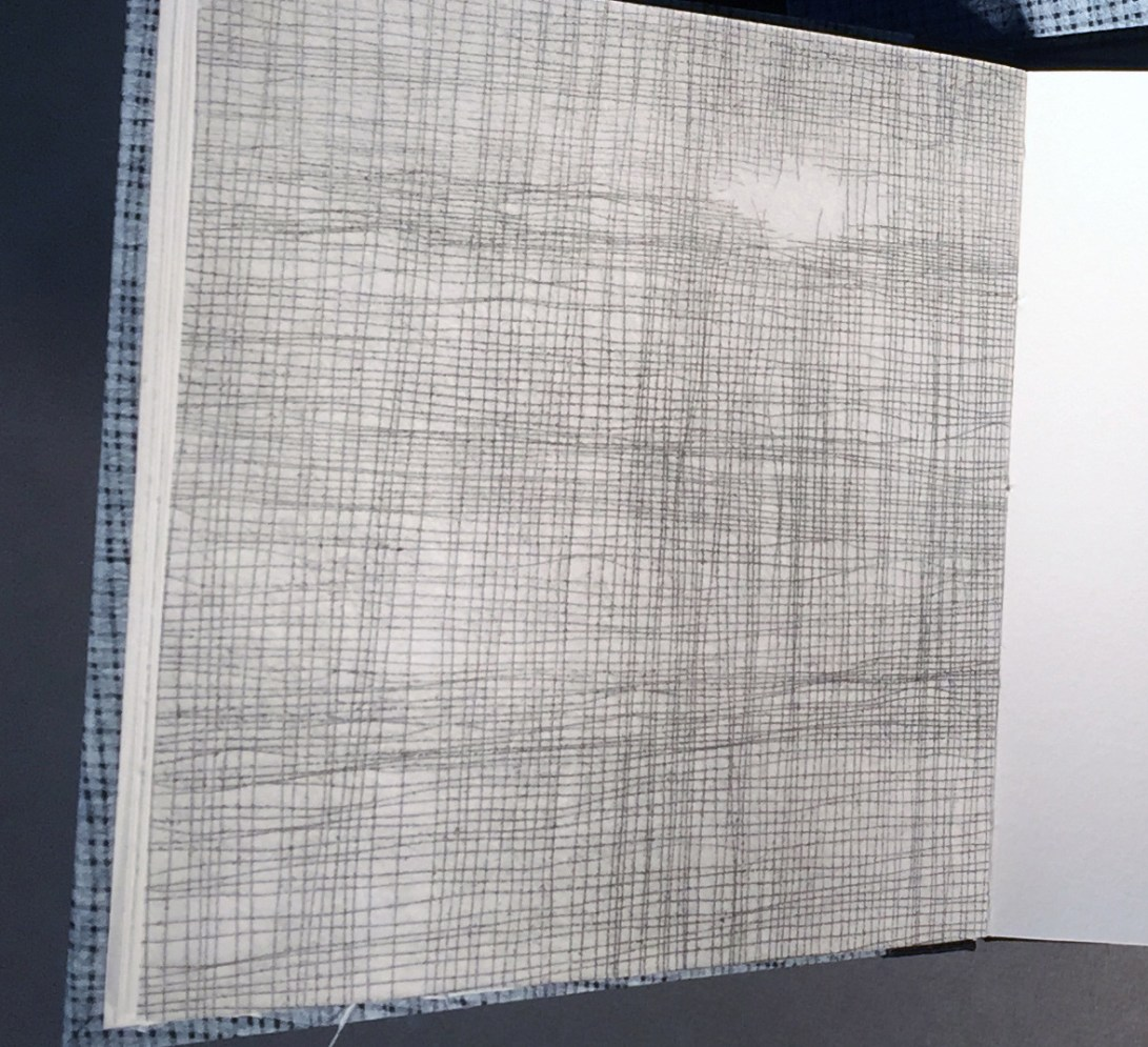 "Close-up view of interior page of an artist book titled ""1 over 1"", artwork that looks like a screen or netting"