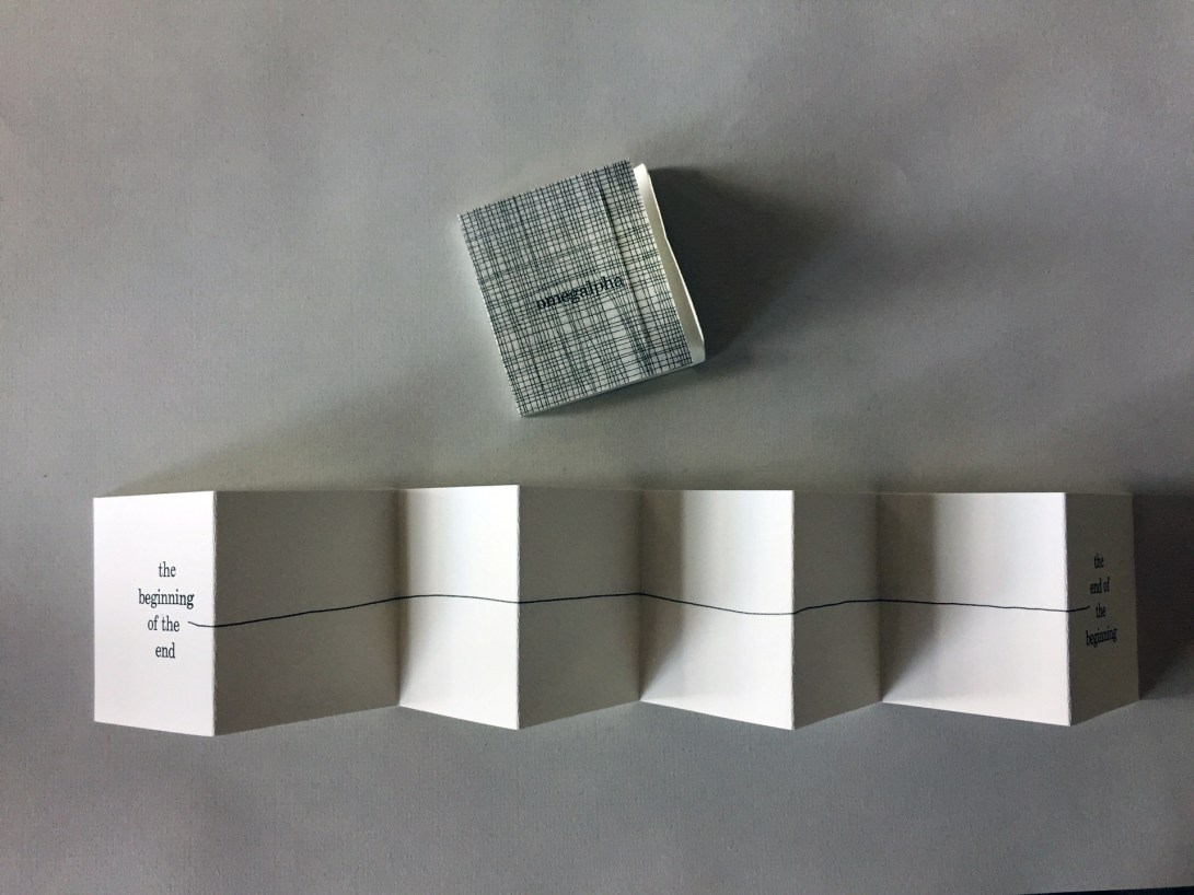 """Wrap and front view of accordion artist book by Wendy Fernstrum titled """"Omegalpha"""""""