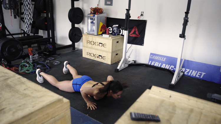 Camille Leblanc-Bazinet demonstrates the third step of a four-count burpee.
