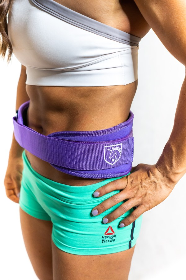 Camille Leblanc-Bazinet wears the purple CLB Fitness weight belt