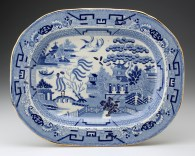 "Paul Scott, ""Cumbrian Blue(s) - A Willow for Ai Weiwei, Wen Tao, Liu Zhenggang, Zhang Jinsong, Hu Mingfen"" 2012, in-glaze decals on partially erased Willow Pattern platter (c.1840), 13.75 x 17""."