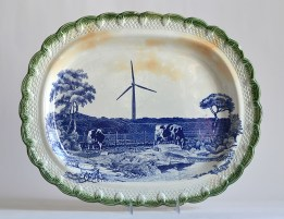 "Paul Scott, ""Scott's Cumbrian Blue(s), American Scenery, Turbine No. 2"" 2015, glaze, decal, gold, c. 1840 green pearlware platter, 15.5 x 19 x 2.25""."