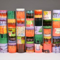"""Lauren Mabry, """"Composition of Enclosed Cylinders"""" 2016, red earthenware, slips, glaze, 24 x 38 x 6""""."""