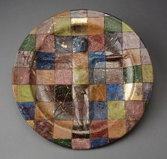 "Robert Arneson, ""A Question of Measure or Checkered Plate or Vitruvian Man"" 1978, ceramic, luster glaze, 18.25"". photo: John Polak (Pennington)"