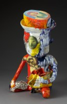 "Micheal Lucero, ""Pre-Columbian Man with George Ohr Pot"" 1991, ceramic, glaze, 17 x 11"". (Pennington)"