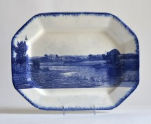 "Paul Scott, ""Scott's Cumbrian Blue(s), American Scenery, Indian Point No 4,"" 2015, glaze, decal, c. 1840 feather-edge pearlware platter, 11.75 x 15.25"". Mount Holyoke College Art Museum Collection."