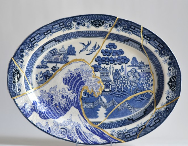 "Paul Scott, ""Scott's Cumbrian Blue(s), Fukushima No: 5,"" 2015, glaze, decal, c. 1965 Japanese Willow platter, brass pins, gold leaf, tile cement, epoxy resin, 14 x 18.75 x 2""."