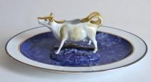 """Paul Scott, """"Scott's Cumbrian Blue(s), Cow in a Meadow (After Damien Hirst)"""" 2015, glaze, decal, gold, Bernardaud porcelain platter: 12.5 x 15.5""""."""