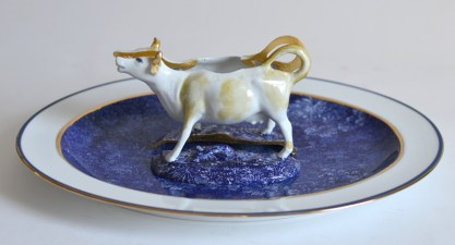 "Paul Scott, ""Scott's Cumbrian Blue(s), Cow in a Meadow (After Damien Hirst)"" 2015, glaze, decal, gold, Bernardaud porcelain platter: 12.5 x 15.5""."