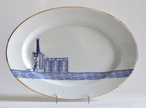 "Paul Scott, ""Scott's Cumbrian Blue(s), Grain Silo,"" 2015, glaze, decal, gold, c. 1850 J K Meakin ironstone platter, 10.25 x 15 x 1.75""."