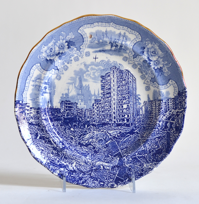 "Paul Scott, ""Scott's Cumbrian Blue(s), Palestine, Gaza,"" 2015, glaze, decal, gold, c. 1840 Adams plate, 9.25 x 1"". Mount Holyoke College Art Museum Collection."