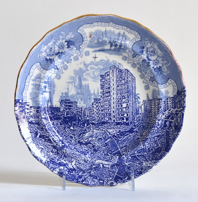 "Paul Scott, ""Scott's Cumbrian Blue(s), Palestine, Gaza,"" 2015, glaze, decal, gold, c. 1840 Adams plate, 9.25 x 1"". Mount Holyoke College Art Museum Collection."