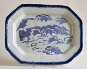 "Paul Scott, ""Scott's Cumbrian Blue(s), Clouds No. 2 after Cadre and Lisa,"" 2015, glaze, decal, gold, on c. 1840 feather-edge pearlware platter, 11.25 x 14.75 x 1.25""."
