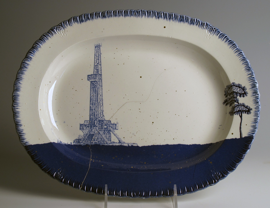 """Paul Scott, """"Cumbrian Blue(s), American Scenery, Fracked No. 1"""" 2013, Inglaze decal collage, gold luster on cracked feather edged Pearlware platter c. 1820, 10.5 x 13.75 x 1.25""""."""