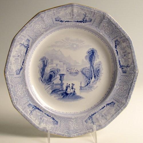 "Paul Scott, ""Scott's Cumbrian Blue(s), Scott's Italian, Costa Concordia No. 2"" 2013, Inglaze decal collage, gold luster on feather edged pearlware plate c. 1820, 9.75""."