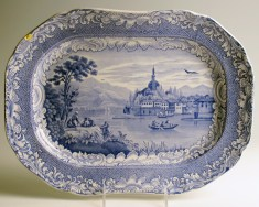"Paul Scott, ""Cumbrian Blue(s), Scenery, Yanina"" 2013, Inglaze decal collage, gold luster on Copeland & Garrett Late Spode, platter c. 1840, 10.75 x 14.75 x 2""."