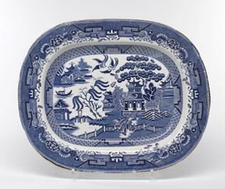 "Paul Scott, ""Cumbrian Blue(s) - A Willow for Ai Weiwei, Wen Tao, Liu Zhenggang, Zhang Jinsong, Hu Mingfen"" 2012, in-glaze decals on partially erased Willow Pattern platter c.1840, 13.75 x 17""."