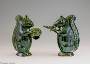 "Michelle Erickson, ""Green Squirrel and The Second Amendment Squirrel"" 2013, indigenous clay, copper glaze, 8""."