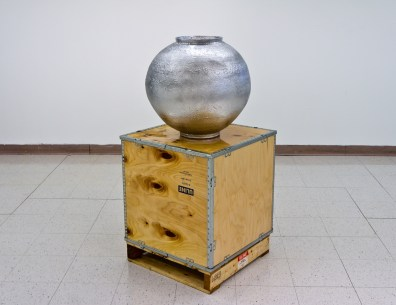 "Joon Park, Moon Jar 2012, clay, crate, pallet, resin, 22 x 22"" (ceramic), 58 x 24"" (complete)."