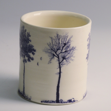 "Paul Scott, ""Scott's Cumbrian Blue(s), Trees (After Spode)"" 2013, inglaze decal collage on Lauren Mabry wheel thrown whiteware cylinder, ~3.5""."