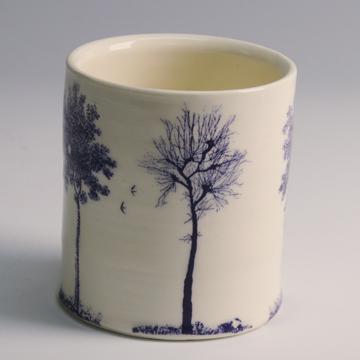 "Paul Scott, ""Scott's Cumbrian Blue(s), Trees (After Spode)"" 2013, inglaze decal collage on Lauren Mabry wheel thrown whiteware cylinder, ~3.5""."