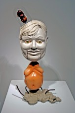 """Sean Erwin, """"The Ego and the Id"""" 2013, polished porcelain, glaze, steel, resin, cast cement, LED lights, glass, flocking, 13 x 8 x 22""""."""